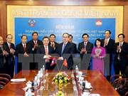 Organizaciones de masas de Vietnam y Laos robustecen cooperación