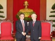 Líder partidista de Vietnam se reúne con jefe de organización de masas de Laos