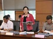 Parlamento vietnamita revisa Ley de Planificación y solución de deudas malas