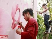 Efectúan en Hanoi el intercambio de pintura mural con el famoso pintor chileno