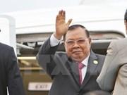 Secretario general de PPRL y presidente de Laos llega a Hanoi