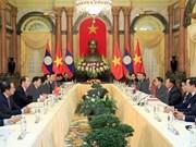 Presidente de Vietnam recibe a secretario general de PPRL y presidente de Laos