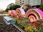 Abierta calle floral Nguyen Hue en Ciudad Ho Chi Minh en días festivos del Tet