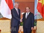 Premieres de Vietnam y Singapur se reúnen en el marco de FEM - ASEAN