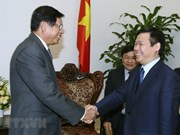 Intercambia Vietnam con Laos experiencias en construcción de modelos económicos colectivos