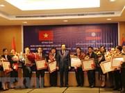 Vietnam y Laos fomentan cooperación laboral y de bienestar social