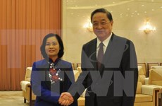 Órganos de masas vietnamita y china robustecen nexos cooperativos
