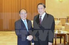 Titular parlamentario vietnamita dialoga con líder de organización china de masas