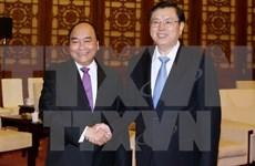 Premier de Vietnam se reúne con presidente de Asamblea Popular Nacional de China