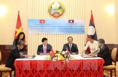Firman Vietnam y Laos acuerdos de cooperación