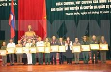 Laos otorga distinciones a excombatientes voluntarios vietnamitas