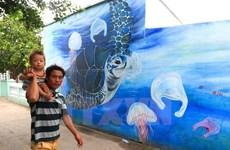 [Fotos] Pinturas murales ayudan a mejorar conciencia pública en isla vietnamitas