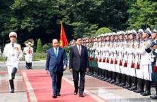 [Foto] Inicia primer ministro de Laos visita oficial a Vietnam