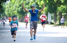Efectúan en Hanoi carrera solidaria con niños desafortunados