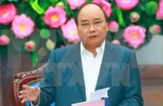 Premier de Vietnam urge a diseñar escenarios de desarrollo para alcanzar objetivo de crecimiento