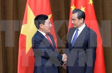 Vicepremier y canciller de Vietnam dialoga con ministro chino de Relaciones Exteriores