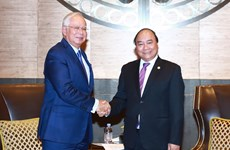 Premieres de Vietnam y Malasia intercambian temas de interés común