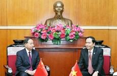 Organizaciones de masas de Vietnam y China intensifican nexos de cooperación