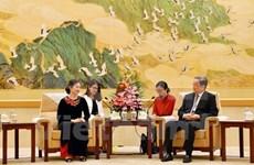 Organizaciones políticas vietnamita y china robustecen relaciones de amistad