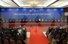 Países integrantes de TPP logran acuerdo de principio, informa ministro japonés