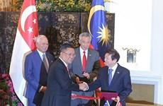 Singapur y Malasia firman acuerdo de transporte