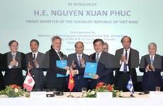 Premier de Vietnam testimonia firma de memorandos de cooperación con Canadá