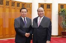 Premier de Vietnam llama a intensificar divulgación sobre relaciones amistosas con Laos