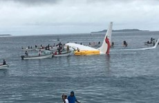Registran cuatro vietnamitas a bordo del avión caído en una laguna de Micronesia