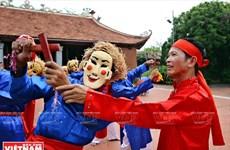 El hombre mantiene el alma de las danzas Xuan Pha