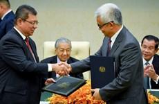 Firman Camboya y Malasia acuerdos en comercio, inversión y turismo