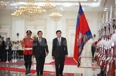 Establecen Camboya y Laos asociación estratégica integral