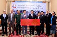 Apoyan vietnamitas residentes en Laos a afectados por desastres naturales