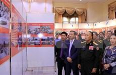 Exposición de fotos resalta aportes de voluntarios vietnamitas a la revolución laosiana