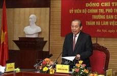 Representantes del Gobierno vietnamita felicitan a policías y pobladores en ocasión del Tet
