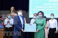 Residentes de Ciudad Ho Chi Minh unen manos para combatir COVID-19