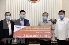 Apoyan empresas vietnamitas a Laos en enfrentamiento al COVID-19