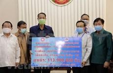 Vietnamitas residentes en Laos respaldan al pueblo laosiano en lucha contra COVID-19