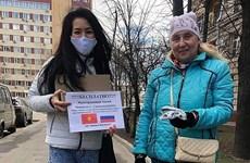 Periódico ruso destaca imágenes de comunidad vietnamita en combate contra epidemia