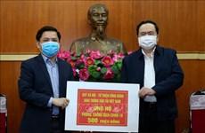 Frente de la Patria de Vietnam recibe asistencias financieras para labores antiepidémicas