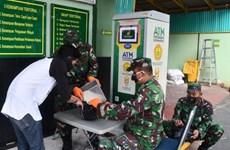"""Indonesia promueve los """"cajeros automáticos"""" de arroz en ayuda a pobladores de menos recursos"""