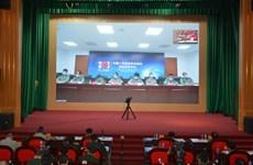 Medicina militar de Vietnam y China comparten experiencias en control del COVID-19