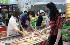 Comerciantes vietnamitas enfrentan dificultades para mantener espacio comercial
