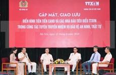 Efectúan intercambio entre representantes destacados de policía popular y VNA