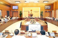 Diputados debaten garantía de derechos para trabajadores vietnamitas enviados al exterior