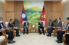 Corroboran cooperación entre alianzas político-sociales de Vietnam y Laos