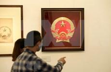Abre sus puertas exposición de esbozo del emblema nacional de Vietnam