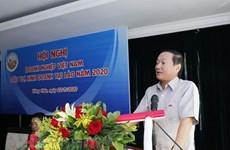 Debaten medidas para estimular operaciones de empresas vietnamitas en Laos