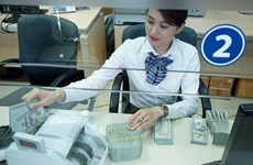Banco Estatal de Vietnam baja el tipo de cambio del dólar estadounidense