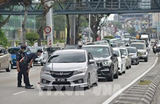 Expertos se muestran cautelosos ante recuperación del mercado laboral de Malasia