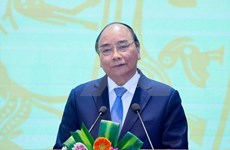 Premier de Vietnam insta a garantizar créditos para las empresas